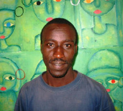 Humorous artist Kibuja in front of painting