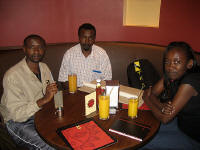 In the Java House with Joseph Thiongo, fellow artist Ndichu Njuguna, and my wife
