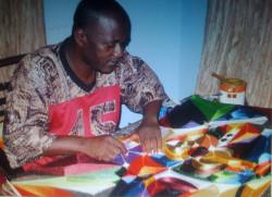 Yeb working on an original silk thread artwork